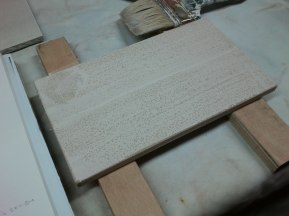 Rabbit skin glue onto muslin