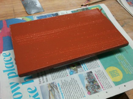 First layer of bole (over gesso panel)