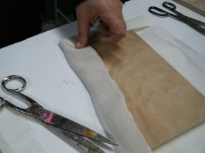Panel being prepped with muslin before glueing